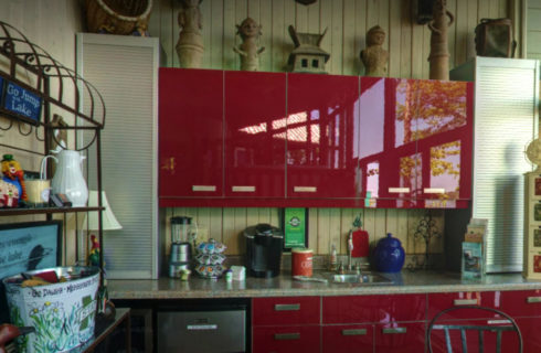 Coffee area in kitchen with red enamel cabinets.